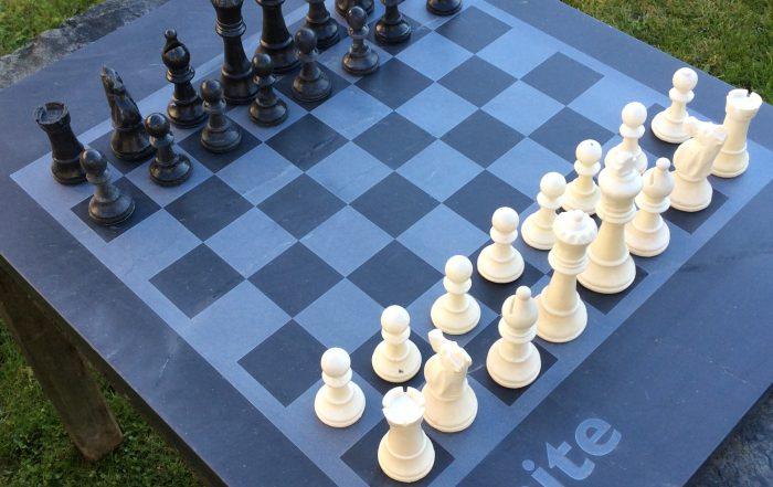 bespoke cornish slate chess board with slate chess pieces