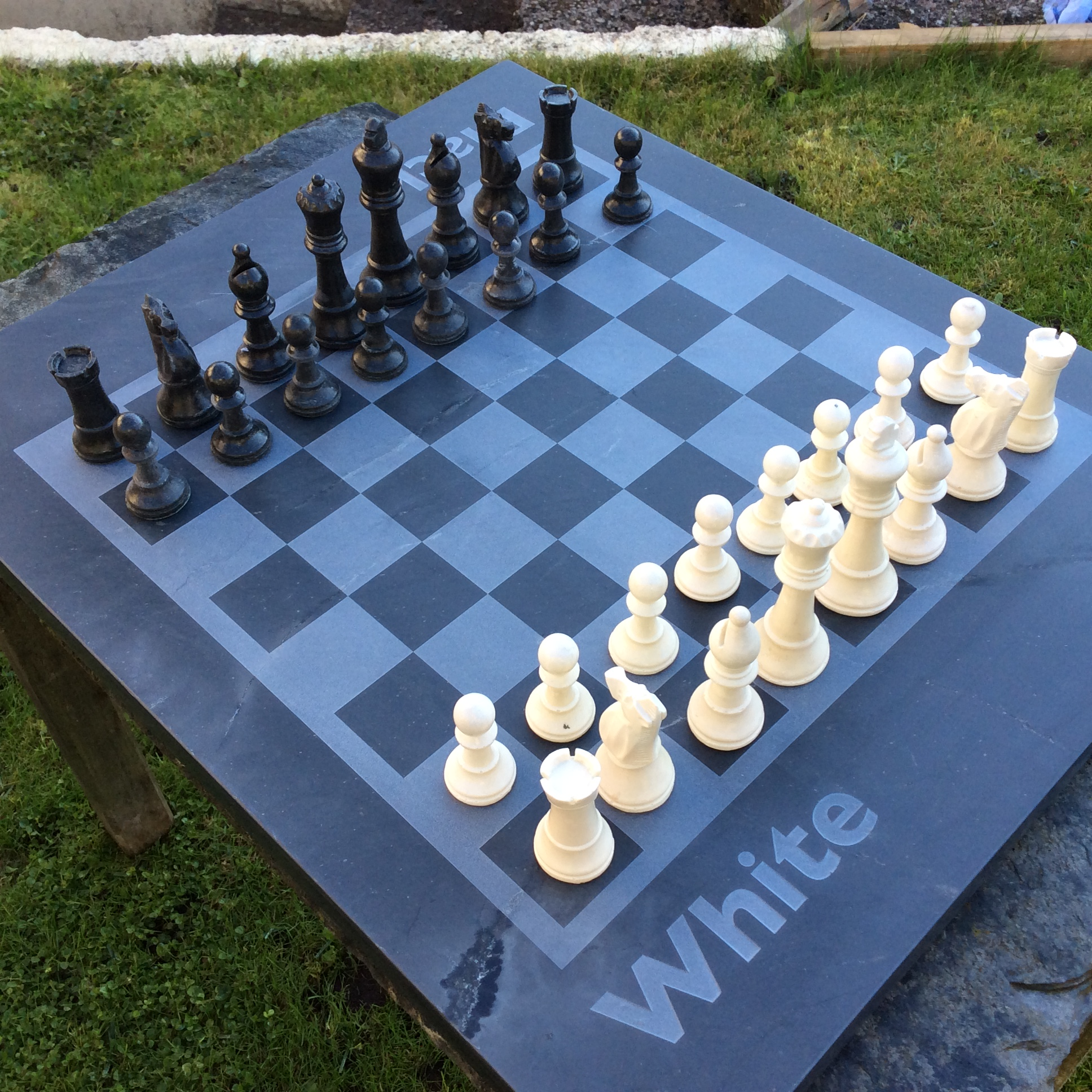 bespoke cornish slate chess board with slate chess pieces